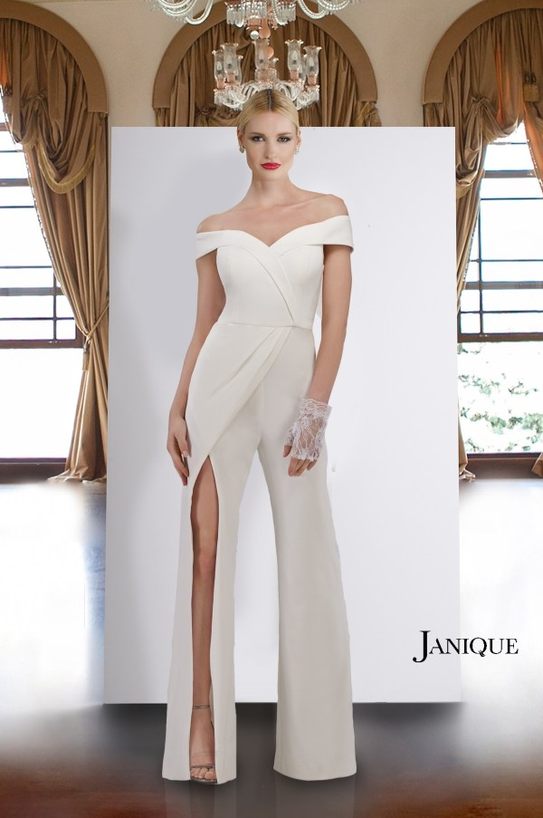 Ivory jumpsuit with slit on pants. Designer jumpsuit in ivory stretch crepe. Jumpsuit with slit in ivory by Janique.