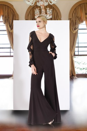 Black jumpsuit with flared bottom pants. Jersey jumpsuit by Janique in black. Lace ruffled long sleeve jumpsuit with pockets.