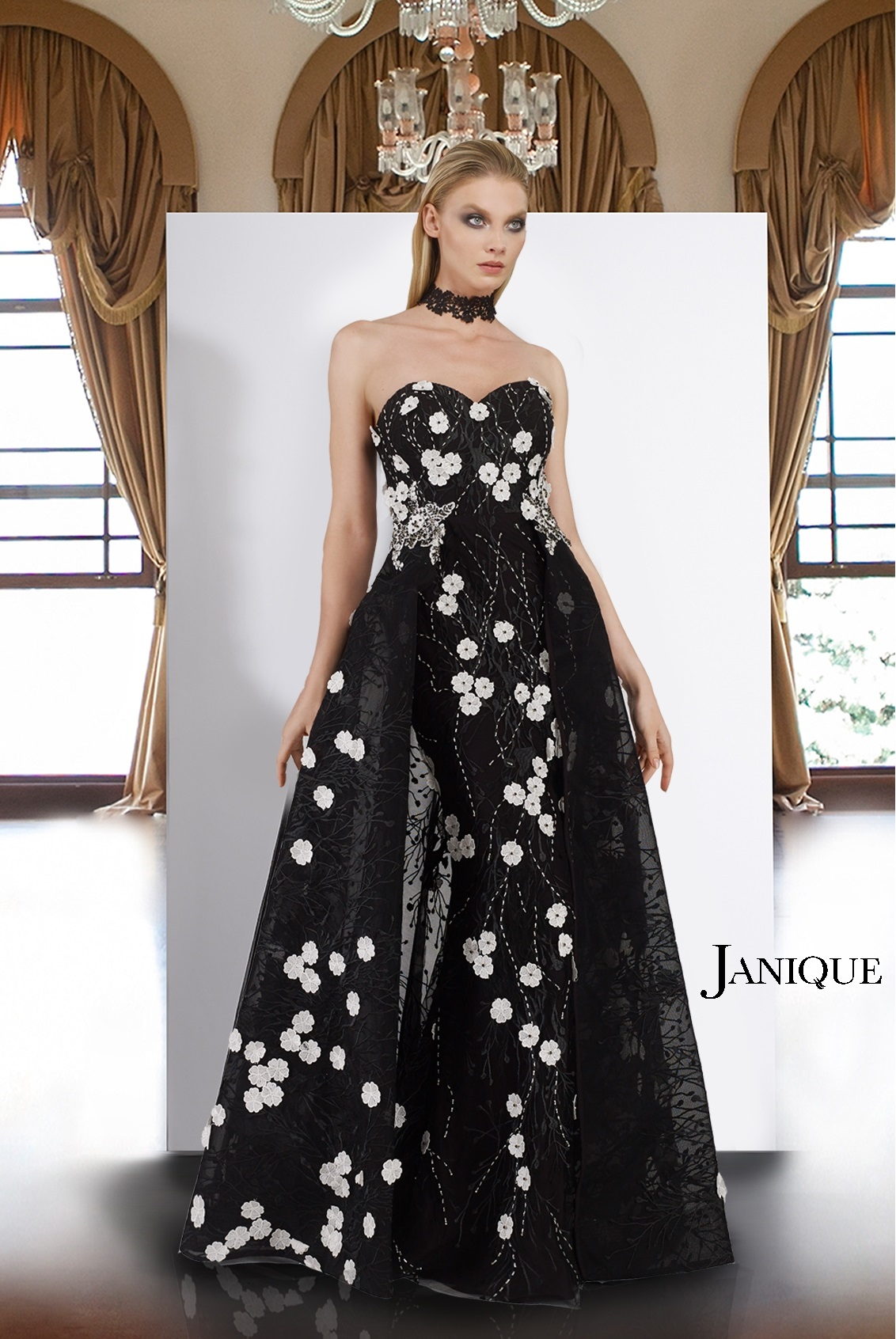 89d2f44ef04 Black and white lace flower applique long gown with overlay skirt.  Strapless white flower applique