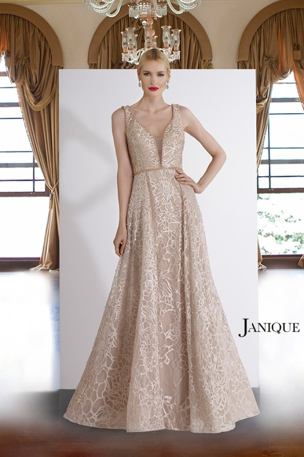 Encrusted plunging neckline with beaded pearl lace long dress. Bridal shoulder strap lace dress with pearls by Janique.