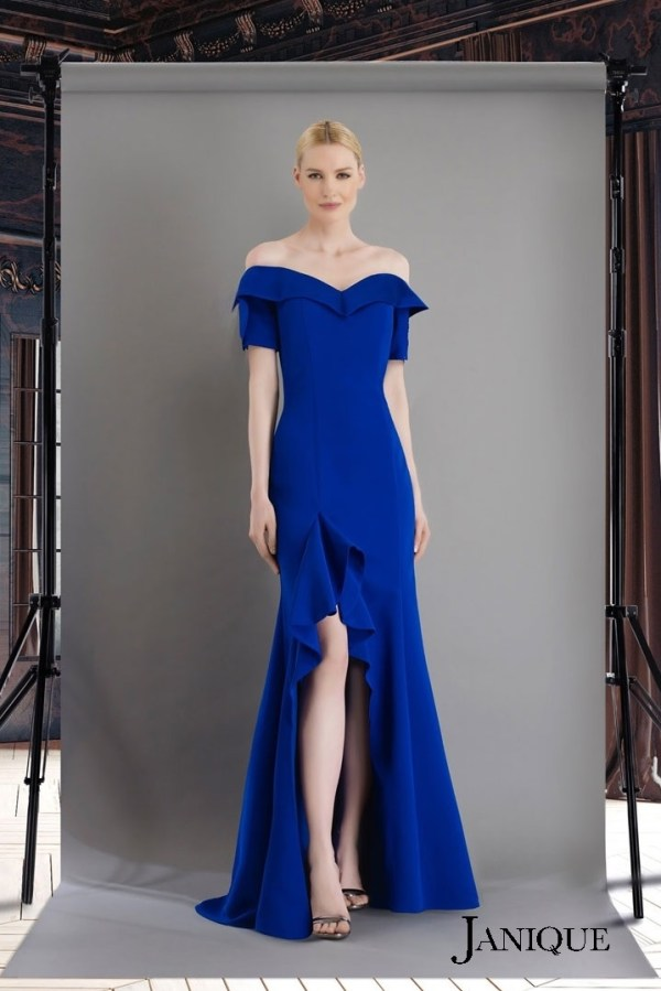 Royal stretch crepe long dress with ruffled slit skirt. Off the shoulder gown with ruffled skirt in royal by janique. Special Occasion Couture
