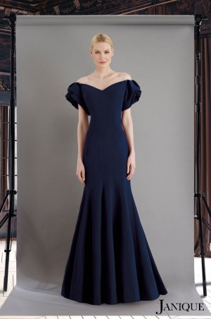 Stretch crepe gown with ruffle short sleeves and ruffle skirt in navy. Navy long dress with ruffle bottom skirt and sleeves.