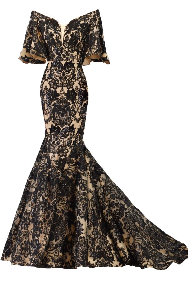 Lace gown with ruffle half sleeve. Black and nude mermaid dress by Janique. Off shoulder dress with embroidery lace.