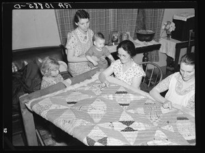 A quilting party in an Alvin, Wisconsin, home