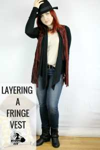 Cute fringe vest outfit. Layering a fringe vest over a black shawl with a tank top and jeans. Put it all together with a cute necklace, hat, and cowboy boots. - Happy Stylish Fit
