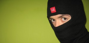 You can totally be an effective ninja with a bright red tag on your black balaclava. Sure. Photo by Vlad Genie on Flickr.