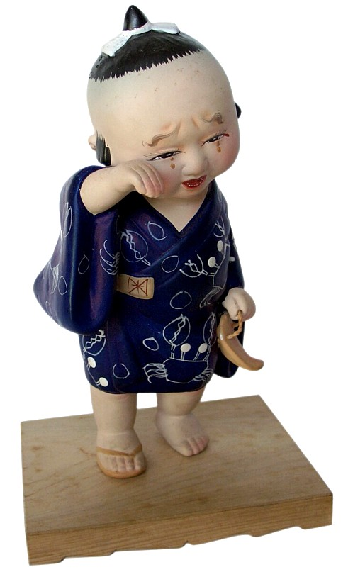 Crying child with broken sandal in his hand Japanese