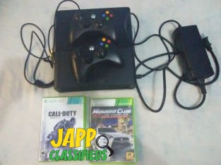XBOX 360 E, TWO CONTROLLERS, TWO GAMES