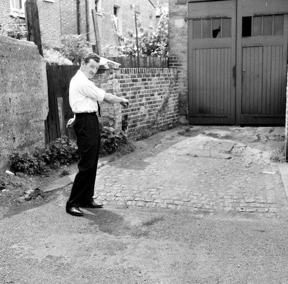 Resident George Heard points to where he found  the body of murder victim Mary Fleming was found, in Berrymede Road, Chiswick July 1964.  Her strangled body was found by George Heard (34) (pictured) from his bedroom window this morning (0450am).  Her death was attributed to the work of a serial killer known as Jack the Stripper.  Also known as, The Hammersmith Murders case 1964-1965, when a serial killer was operating in London and killed 6-8 women prostitutes ; dumped their bodies around london or in the River Thames.  The serial killer has never been caught. *** Local Caption *** George Heard (34) of 53 Berrymede Road