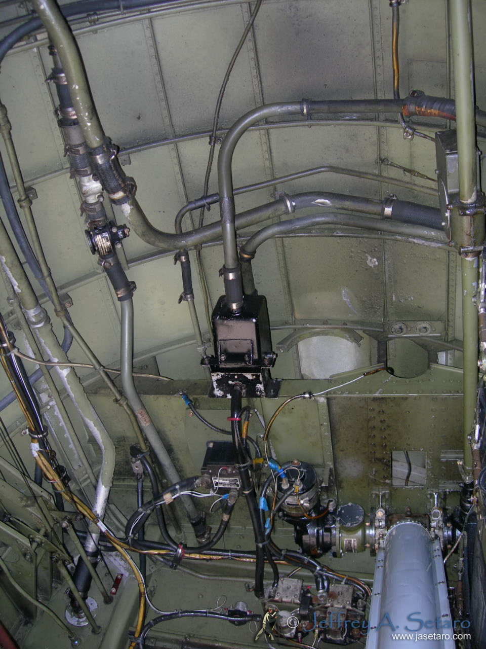 The interior of one the Nine O Nine's main landing gear wheel wells.