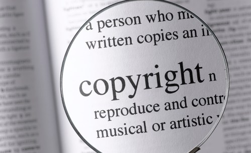 Magnifying Glass Highlighting Copyright