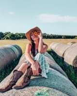 Girl on haybale