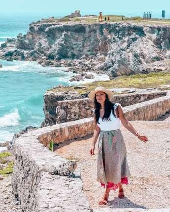 girl looking at lizard on island