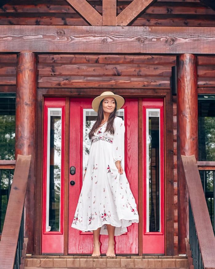 cabin entrance girl in white dress