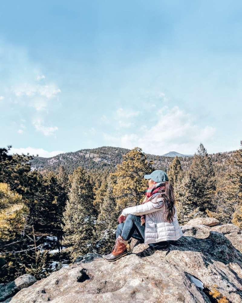 Sitting on a boulder at Alderfer Three Sisters Park, Evergreen - a hidden gem near Denver, Colorado.