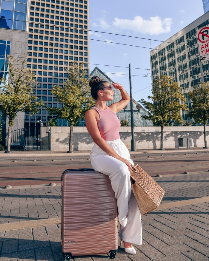 girl with luggage in the city