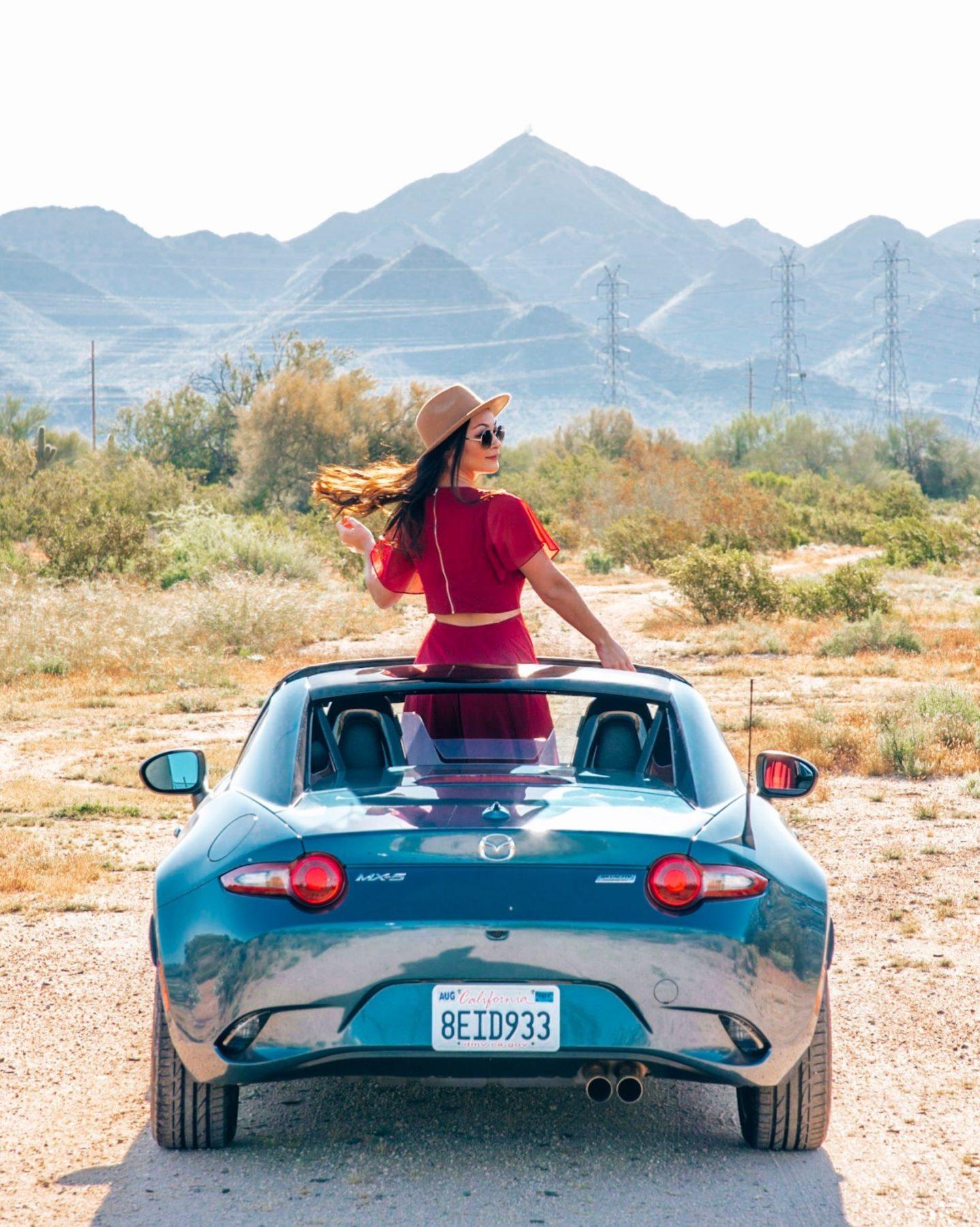 girl in mazda miata in the desert