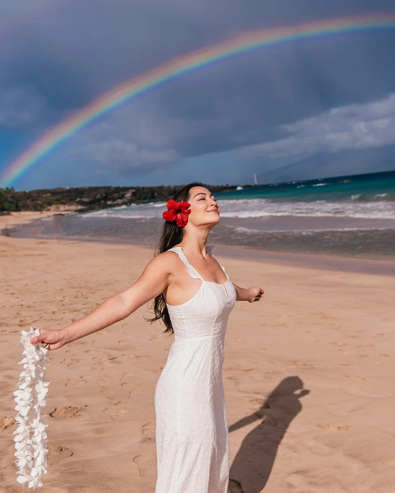 girl in front of rainbow in Maui