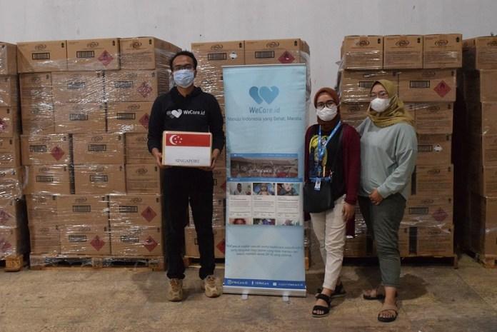 Pemerintah Singapura Berikan Dukungan APD 160 Ton pada Indonesia