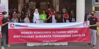 Alfamidi Sumbang 100 Paket Sembako