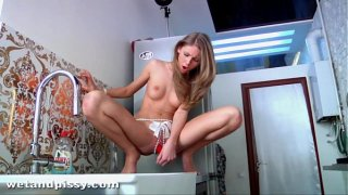 Krystal boyd pisses and fucks her pussy on the kitchen side