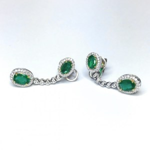A photograph of some 18ct White Gold Emerald & Diamond Drop Earrings