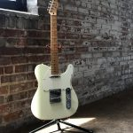 Image of guitar in old factory