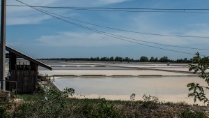 Salt fields along side the tracks of the Mae Klong train