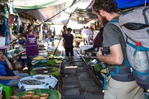 Pierre looking at all of the food at the Mae Klong Market.