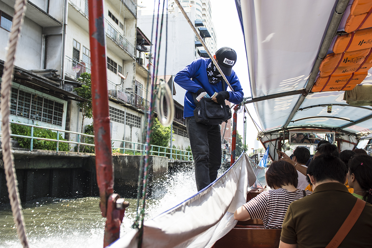 Time to pay our fare for the Klong boats that travel through the canals of Bangkok.