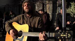 "Neil Halstead - singing and playing guitar in the ""Elevenses"" music video"
