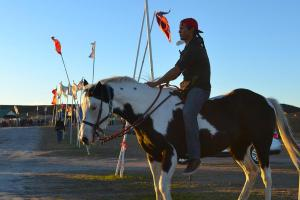 Native Water Protector on Horseback at Oceti Sakowin