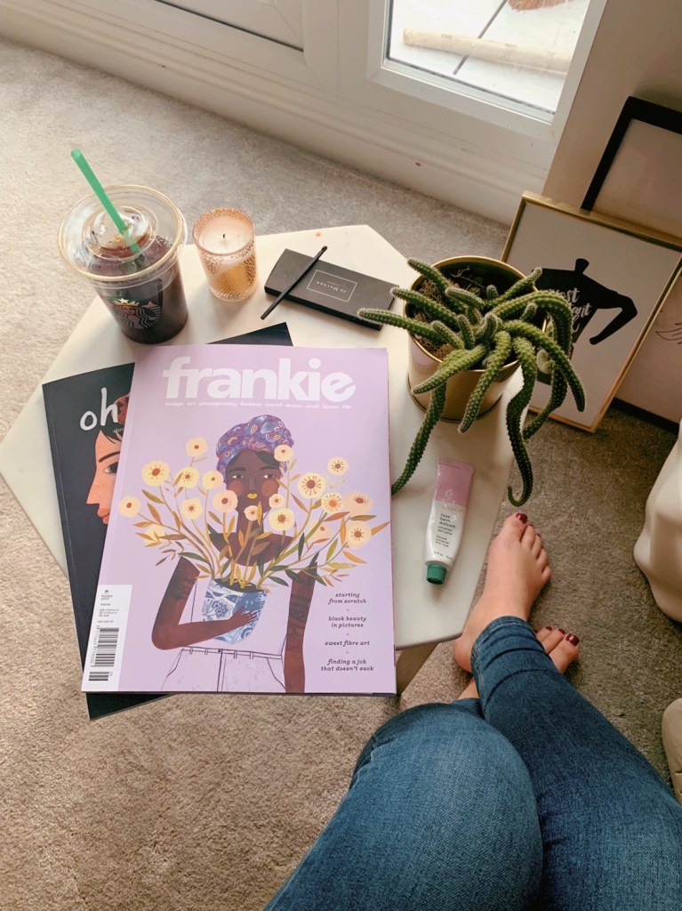 Side table with Frankie Magazine, plant, candle and matches