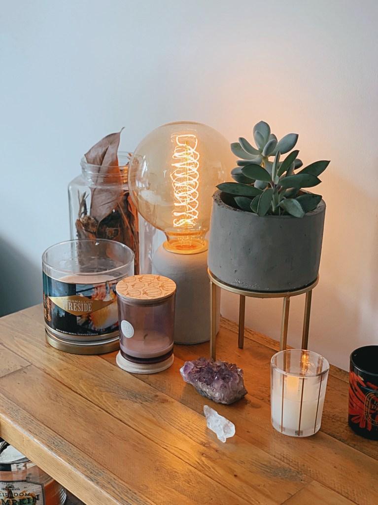 Jaye Rockett home sidetable succulent candles crystals filament bulb lamp