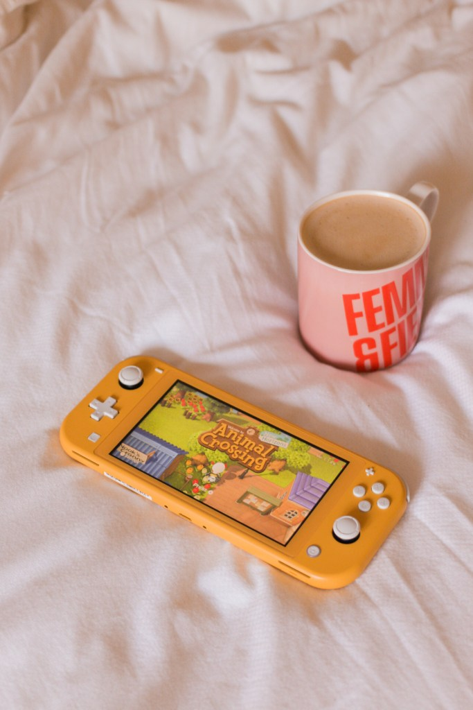 Lockdown loves jaye rockett animal crossing on nintendo switch with coffee on bed