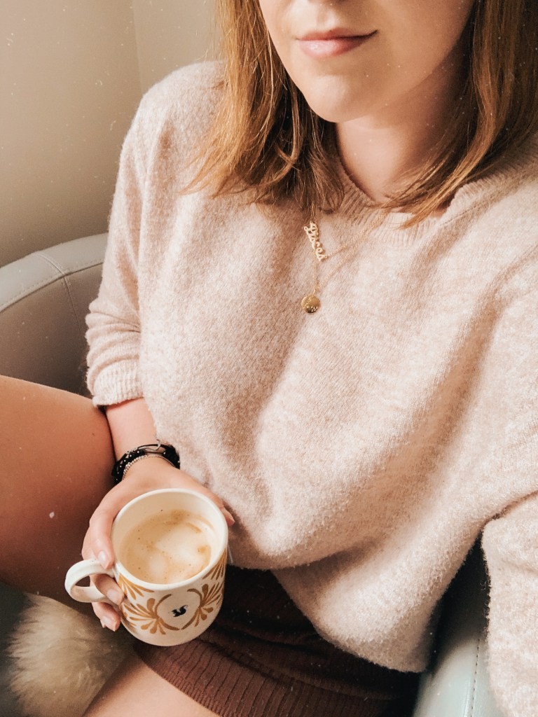 i struggle with friendships, jaye rockett. mug of coffee selfie with beige jumper.