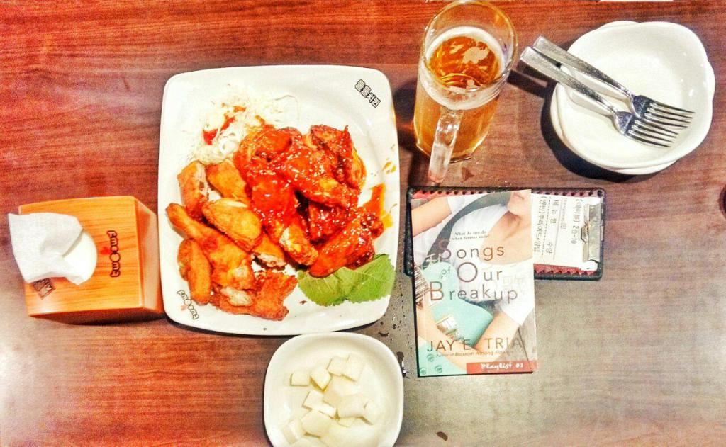 Chimaek and a book. Songs of Our Breakup in Two Two Chicken. Myeongdong. Photo by Ace Tria.