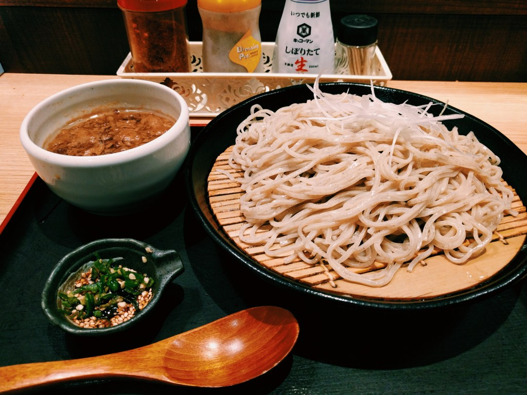 My vendo meal. Noodles with a hot, spicy dipping sauce. Perfect for the cold. We asked for house tea but the kind shop man told us it's better to slurp the sauce and drink water instead. Asakusa, Tokyo.