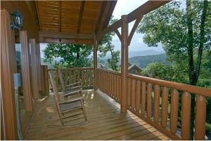 A Sweet Retreat is a one bedroom, 2 bath cabin with a mountain view, screened porch, and theater room located in Pigeon Forge.