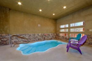 Alpine Pool Lodge is a 2 bedroom cabin with a private heated indoor pool and amazing location just a couple minutes to the Parkway in Pigeon Forge