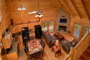 Autumn Blessings is a two bedroom cabin rental in Pigeon Forge featuring two huge master suites, large loft game room, floor to ceiling fireplace in family room, and great deck space