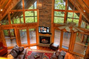 Blessings is a beautiful four bedroom cabin in Pigeon Forge with a beautiful mountain view. It also features a huge family room with large window wall, unique game room area with bar, several fireplaces, and great decking. The gated resort offers a community pool, tennis courts, and more