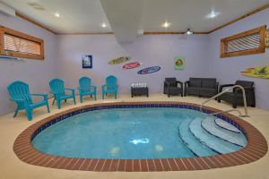 Mountain Pool Lodge is a four bedroom rental cabin with an indoor pool with theater, mountain view, and great convenient location to the Parkway.