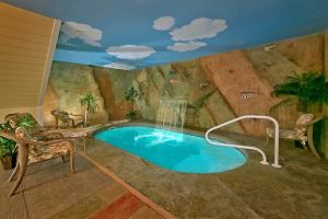 Mountain Splash is a one bedroom rental cabin in Gatlinburg with an indoor pool and mountain view. It is a perfect cabin for honeymooners.
