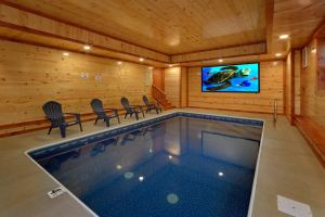 Paradise Point Pool Lodge is a luxury 6 bedroom cabin with an indoor pool, theater room, mountain view, and private location. Located near Pigeon Forge in the Smoky Mountains