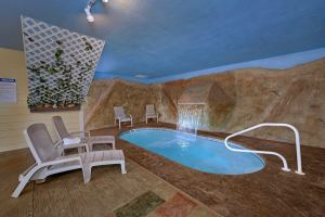 Pool Time Paradise is a one bedroom Gatlinburg rental cabin that features an indoor pool and mountain view