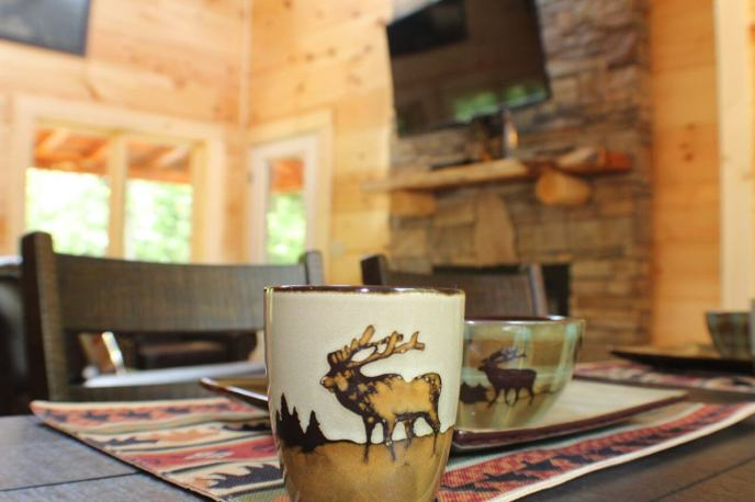 Elk mug at the dining table of Poolin' Around. A luxury cabin rental in Pigeon Forge
