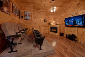 Smoky Mountain Lodge is a seven bedroom cabin in Pigeon Forge with a theater room and great location next to the Parkway