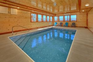 Summit Pool Lodge is a huge six bedroom cabin in Pigeon Forge with an indoor pool, arcade, theater room, and mountain view