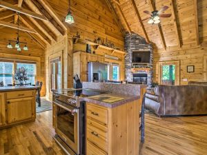 Whispering Pines is a luxury three bedroom cabin in Pigeon Forge. It features a screened porch, beautiful stone fireplace, large lower level game room and more